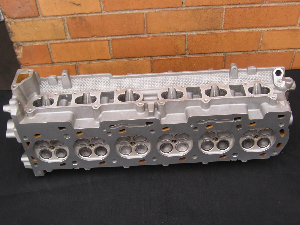 Ford Valve Twin Cam Six Cylinder Head on Rebuilt Chevy 6 Cylinder Engines