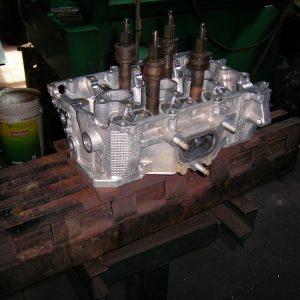 Press Straightening a Bent Head. [Engine Machining].