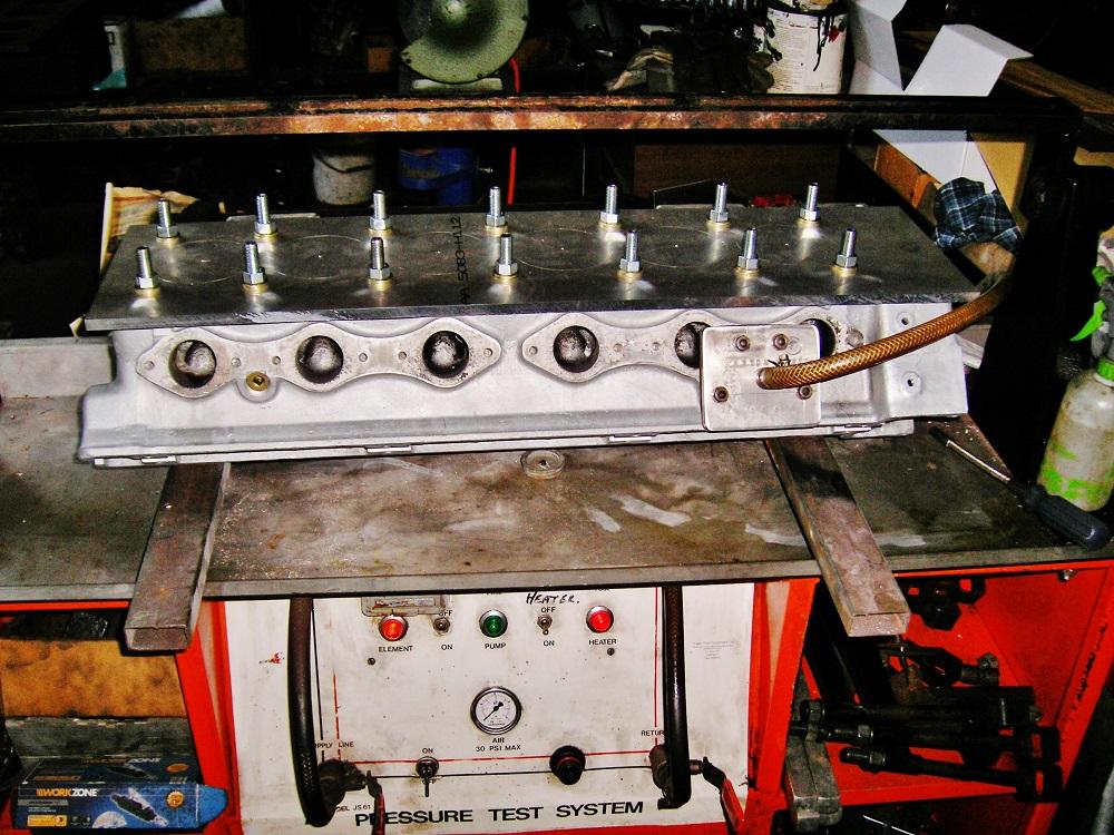 Pressure Testing an Aston Martin 6 Cylinder Head.